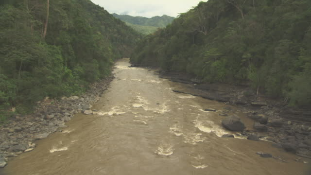 aerial track through gorge over river. - papua stock videos and b-roll footage