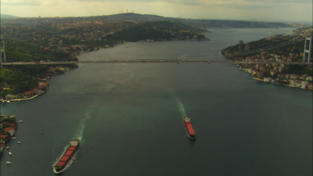 aerial ha track towards and over bosphorus bridge in istanbul - july 15 martyrs' bridge stock videos & royalty-free footage