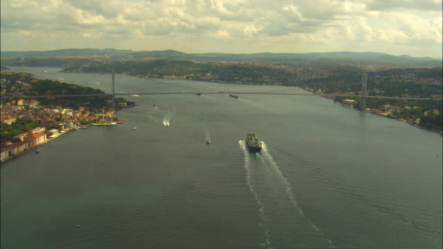aerial ha track towards and over bosphorus bridge in istanbul - bosphorus stock videos & royalty-free footage
