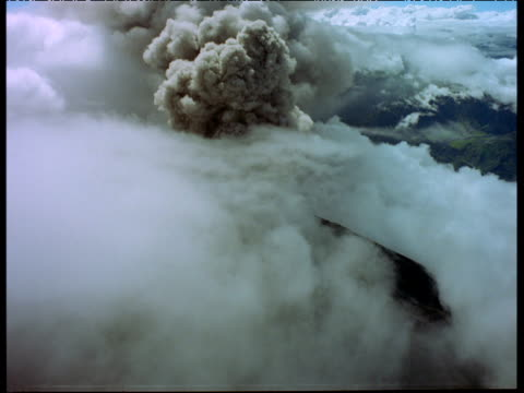aerial track towards huge plume of smoke and steam emerging from erupting volcano - erupting stock videos and b-roll footage