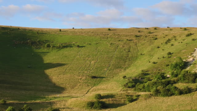 4k aerial track towards long man of wilmington - paganism stock videos and b-roll footage