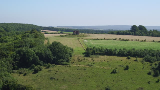 aerial track towards ruin on south downs - rolling landscape stock videos & royalty-free footage