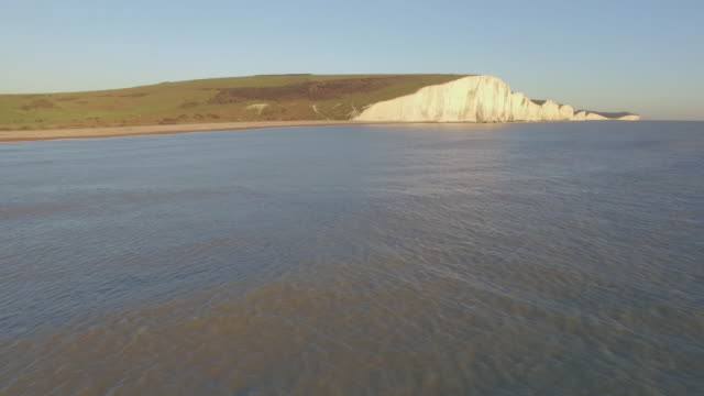 aerial track towards seven sisters cliffs - english channel stock videos and b-roll footage