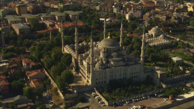 aerial ha track towards then over suleymaniye mosque - suleymaniye mosque stock videos and b-roll footage