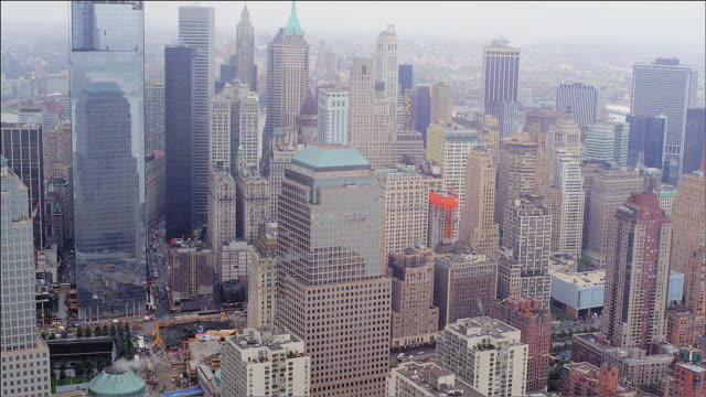 aerial track up the lower west side of manhattan island, new york. foggy day. - money politics stock videos & royalty-free footage