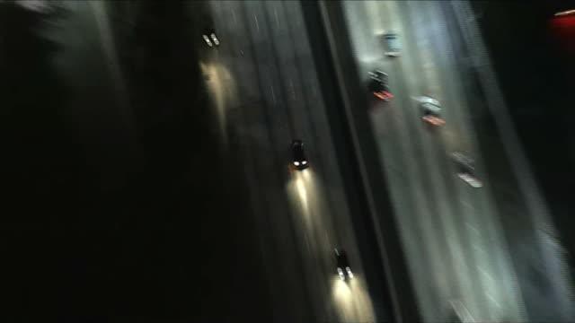aerial tracking black sedan at night in la - sedan stock videos & royalty-free footage