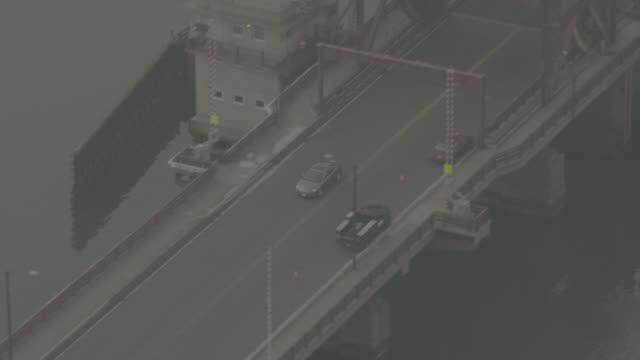 aerial tracking car driving over andrew mcardle, meridian st, bridge. drawbridge. - drawbridge stock videos and b-roll footage