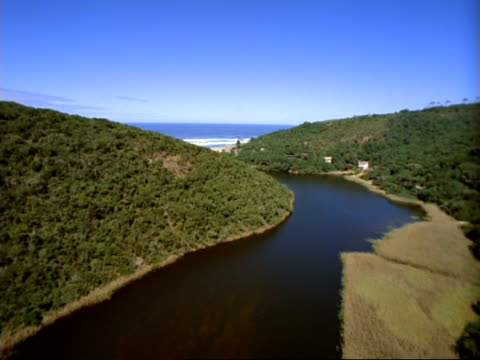 WA Aerial tracking over river leading out to sea, South Africa