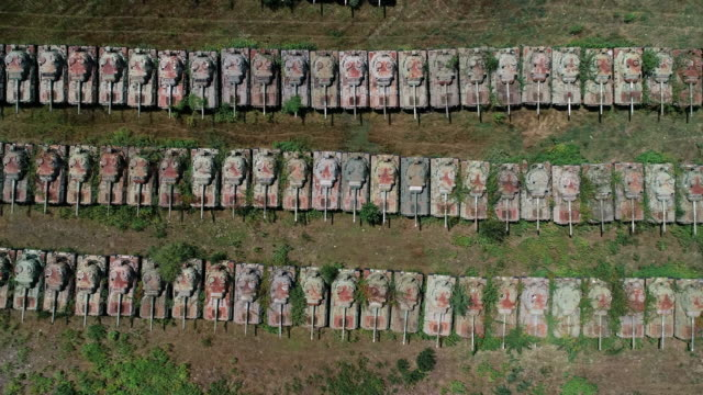 aerial tracking shot above rows of tanks, italy - gun barrel stock videos & royalty-free footage