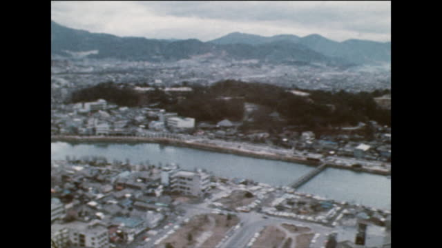 aerial tracking shot along river in hiroshima, japan; 1975 - nuclear bomb stock videos & royalty-free footage