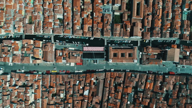 aerial tracking shot directly above chioggia, italy - city life点の映像素材/bロール