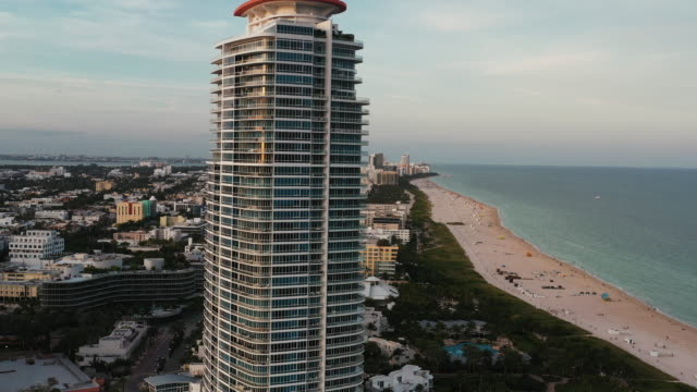 aerial tracking shot of a skyscraper in miami beach, florida, united states of america - miami stock videos & royalty-free footage