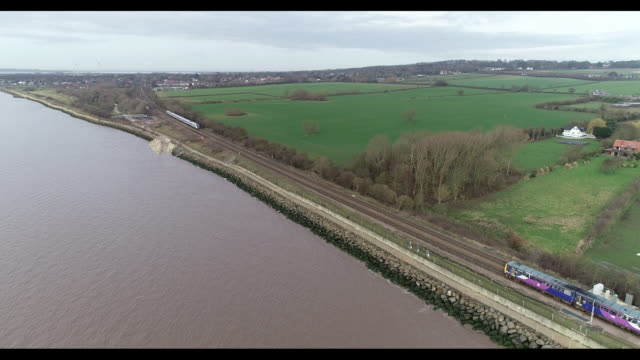 aerial tracking shot of a train moving through hull - 1 minute or greater stock videos & royalty-free footage