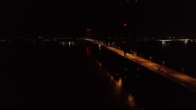 aerial tracking shot of the humber bridge at night - hull stock videos & royalty-free footage