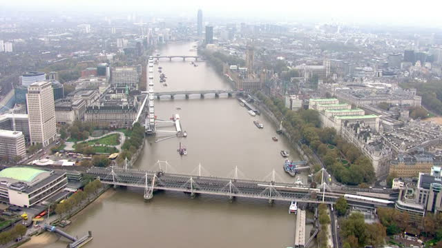 aerial tracking shot of the thames showing the houses of parliament london eye and the sis building or mi6 building at vauxhall cross houses the... - lambeth stock-videos und b-roll-filmmaterial