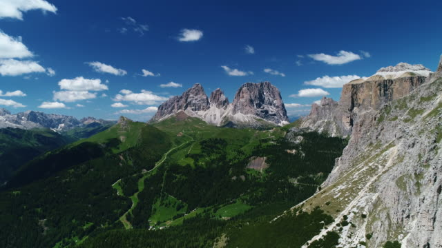 aerial tracking shot showing a dolomite landscape in the summer, italy - ridge stock videos & royalty-free footage