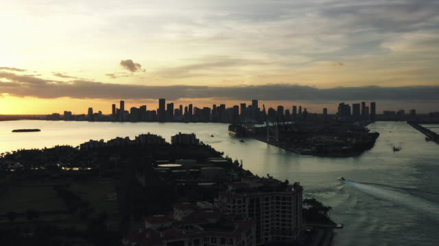 aerial tracking shot showing an area of miami beach at sunset, florida, united states of america - miami dade county stock videos & royalty-free footage