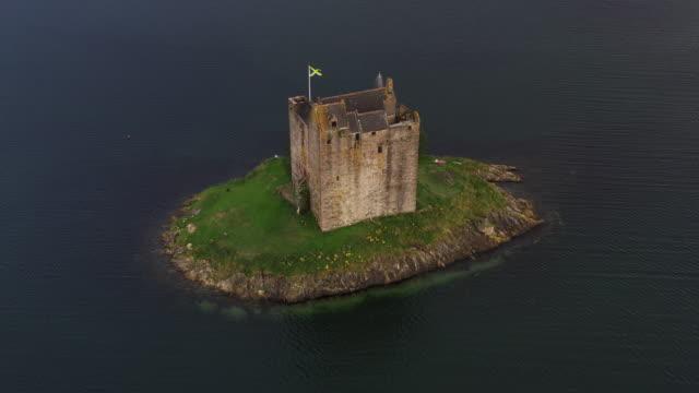 aerial tracking shot showing castle stalker, scottish highlands, united kingdom - fortress stock videos & royalty-free footage
