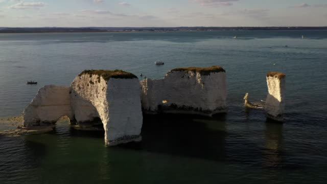 aerial tracking shot showing chalk cliffs of old harry rocks, dorset, england, united kingdom - rock face stock videos & royalty-free footage