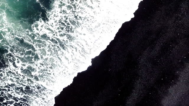aerial tracking shot - black sand stock videos & royalty-free footage