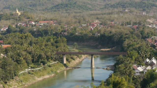 aerial. traffic bridge in luang prabang in laos. - laos stock videos and b-roll footage