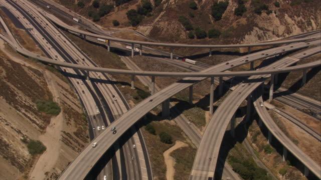 Aerial TS HA traffic on multiple freeways /  San Fernando Valley, California, United States