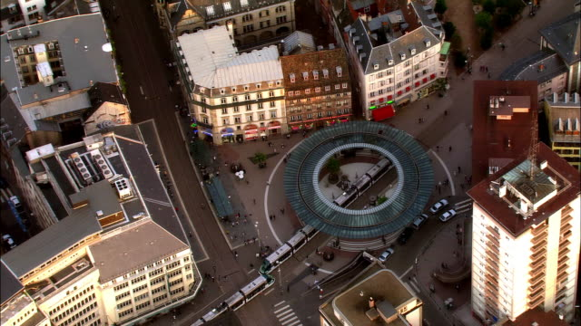 Aerial WS Trams passing through modern station / Strasbourg, Alsace, France