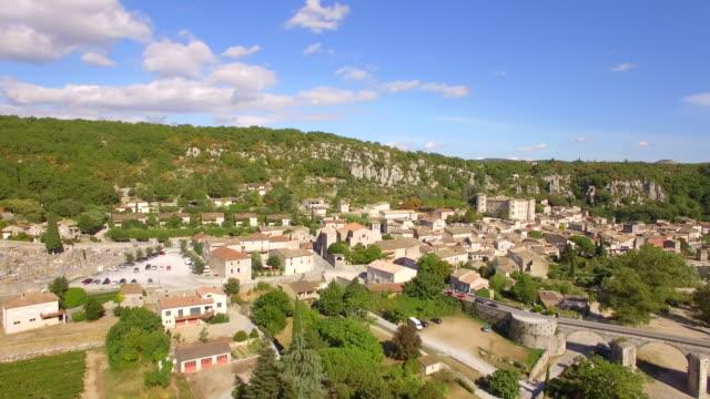 vidéos et rushes de aerial travel drone view of balazuc, southern france. - village