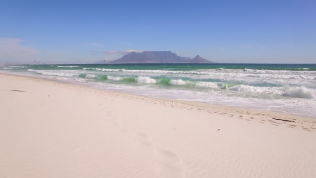 Aerial travel drone view of Table Mountain and Table Bay from Bloubergstrand, Cape Town, South Africa.