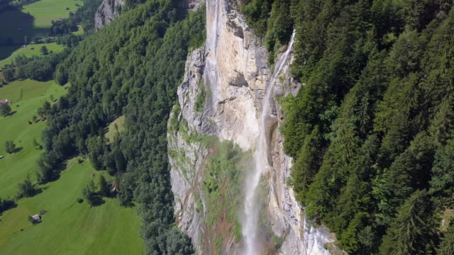 aerial travel drone view of the lauterbrunnen valley and staubbach falls, switzerland. - goodsportvideo stock videos and b-roll footage