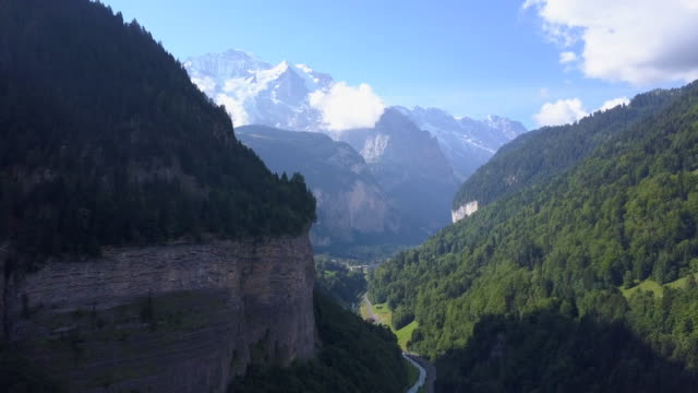 aerial travel drone view of the lauterbrunnen valley, switzerland. - goodsportvideo stock videos and b-roll footage