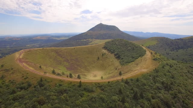 Aerial travel drone view of the Puy de Dome, lava dome volcano in France.
