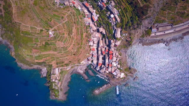 aerial travel view of manarola, cinque terre, italy. - cinque terre stock videos and b-roll footage