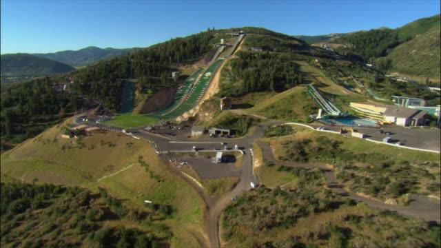 aerial traveling over utah olympic park ski jump / park city, utah - park city utah stock videos and b-roll footage