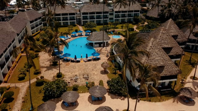 aerial/ tropical beach resort - 顕花植物点の映像素材/bロール