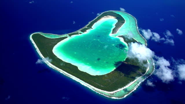 aerial tropical view of french polynesia vacation islands - isola di tahaa video stock e b–roll