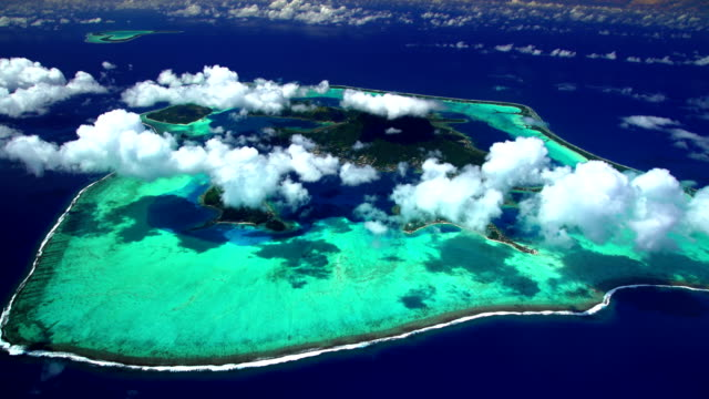 aerial tropical view of tupai and bora bora - bora bora aerial stock videos and b-roll footage