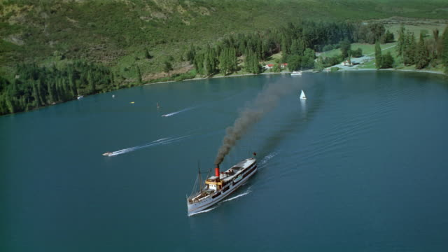 aerial tss earnslaw sailing in lake wakatipu / walter peak sheep station on shore / south island - steam liner stock videos & royalty-free footage