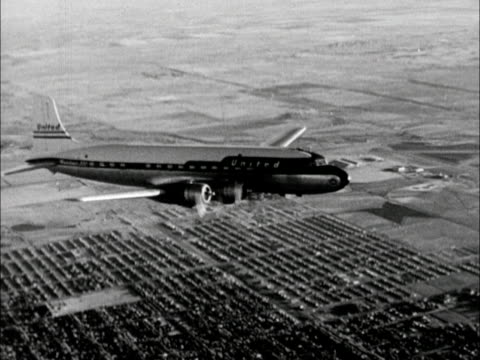 Transportation Aerial United Douglas Dc6 Commercial Airline Aircraft In Domestic Flight Housing Development Clustered Below United