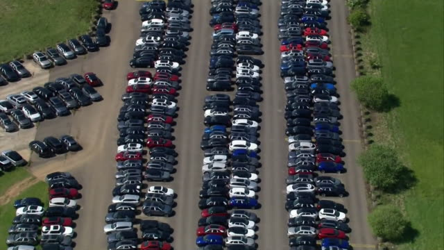 aerial unsold cars being parked at a former raf base as sales in the motor industry collapsed during coronavirus crisis - stationary stock videos & royalty-free footage