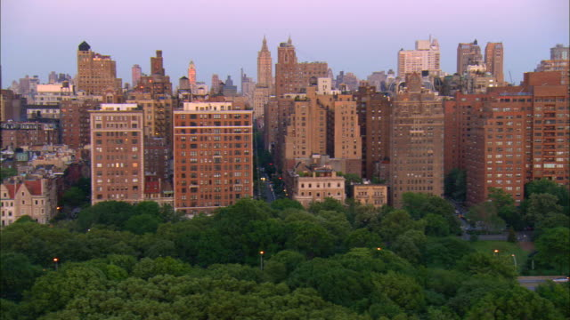 aerial ws upper west side looking down streets along central park with view of san remo apartments / manhattan, new york, new york, usa - upper west side manhattan stock videos and b-roll footage