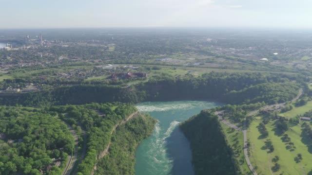 h1-9 aerial upper whirlpool trails and niagara river view, niagara falls, ontario, canada - niagara falls city new york state stock videos & royalty-free footage