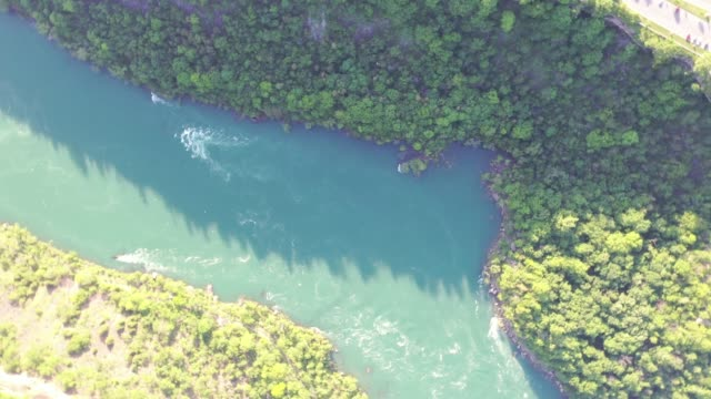 h1-9 aerial upper whirlpool trails and niagara river view, niagara falls, ontario, canada - niagara falls city new york state stock videos & royalty-free footage
