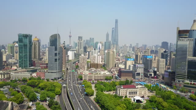 aerial, urban cityscape in shanghai, china - stadtzentrum stock-videos und b-roll-filmmaterial