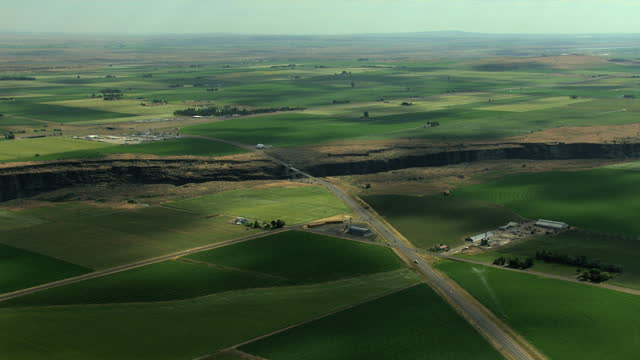aerial usa idaho farm crops food land agriculture water - aerial transport building stock videos & royalty-free footage