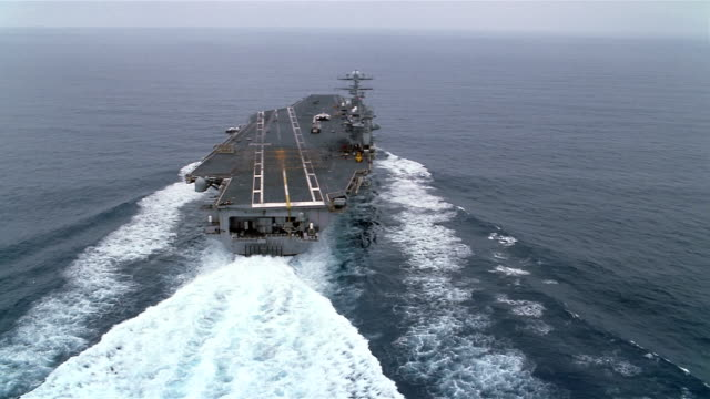 aerial uss carl vinson sailing in pacific ocean / california - aircraft carrier stock videos & royalty-free footage