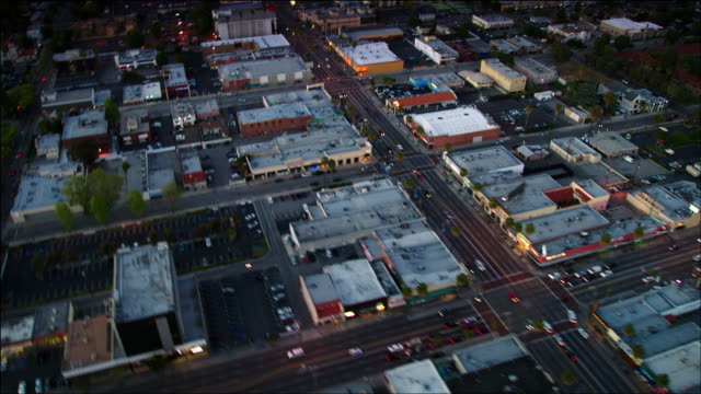 Aerial POV, Van Nuys Boulevard in the San Fernando Valley, Light Industrial, Warehouses, and Retail buildings, Los Angeles, CA, early evening.