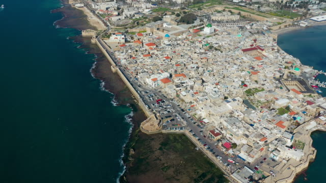 aerial: vast view of city of acre and boat sailing - akko stock videos and b-roll footage