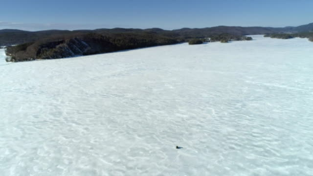 aerial vehicle driving over frozen lake, vermont - vermont stock videos & royalty-free footage