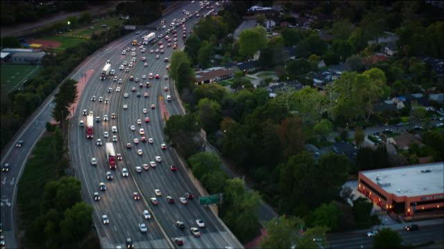 Aerial POV, Ventura Freeway, traveling west through the San Fernando Valley, in Los Angeles, CA, early evening.